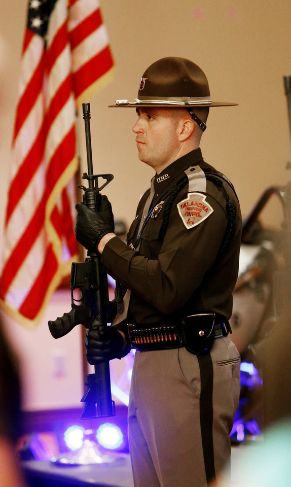 Photo -  A trooper stands at attention during the presentation of the colors at the Trooper of the Year Awards on Wednesday in Norman. Photo by Steve Sisney, The Oklahoman   STEVE SISNEY -  THE OKLAHOMAN