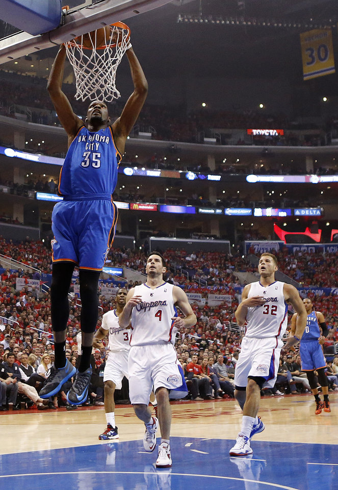 Photo - Oklahoma City's Kevin Durant (35) dunks in front of Los Angeles' J.J. Redick (4) and Blake Griffin (32) during Game 3 of the Western Conference semifinals in the NBA playoffs between the Oklahoma City Thunder and the Los Angeles Clippers at the Staples Center in Los Angeles, Friday, May 9, 2014. Photo by Nate Billings, The Oklahoman