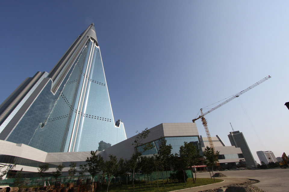 Photo -   In this Sept. 23, 2012 photo released by Koryo Group on Wednesday, Sept. 26, the pyramid-shaped 105-story Ryugyong Hotel stands in Pyongyang, North Korea. A foreign tour agency said the interior of the massive, hotel in the North Korea capital remains unfinished. Beijing-based Koryo Tours got a sneak peek inside the hotel that has been an off-limits construction site and remains a source of fascination for the outside world. (AP Photo/Koryo Group) EDITORIAL USE ONLY, NO SALES