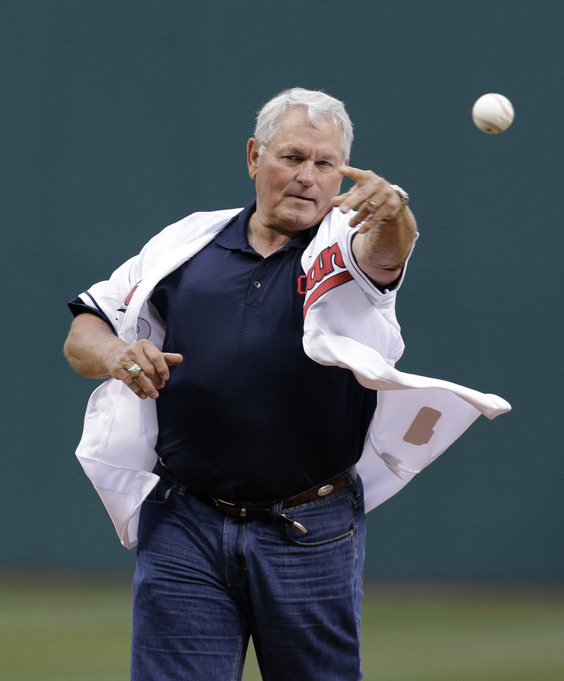 Photo - Former Cleveland Indians manager Mike Hargrove throws out the ceremonial first pitch before a baseball game between the Minnesota Twins and the Cleveland Indians, Friday, April 4, 2014, in Cleveland. (AP Photo/Mark Duncan)