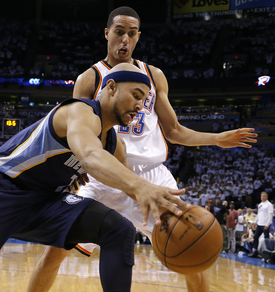 Oklahoma City's Kevin Martin (23) pressures Memphis' Jerryd Bayless (7) during Game 5 in the second round of the NBA playoffs between the Oklahoma City Thunder and the Memphis Grizzlies at Chesapeake Energy Arena in Oklahoma City, Wednesday, May 15, 2013. Memphis won 88-84.  Photo by Bryan Terry, The Oklahoman