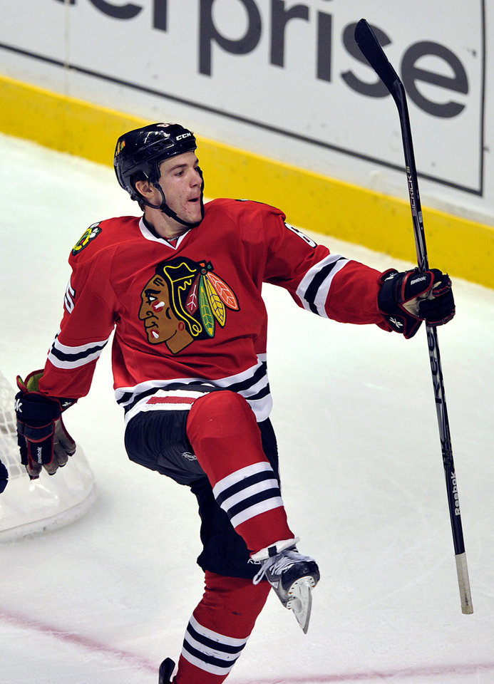 Chicago Blackhawks\' Andrew Shaw celebrates his goal against the Columbus Blue Jackets during the second period of an NHL Hockey game Sunday, Feb. 24, 2013, in Chicago. (AP Photo/Jim Prisching)
