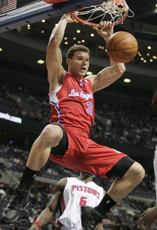 Photo - L.A. CLIPPERS: Los Angeles Clippers' Blake Griffin dunks against the Detroit Pistons in the first half of an NBA basketball game Friday, Dec. 17, 2010, in Auburn Hills, Mich. (AP Photo/Duane Burleson) ORG XMIT: DTP103