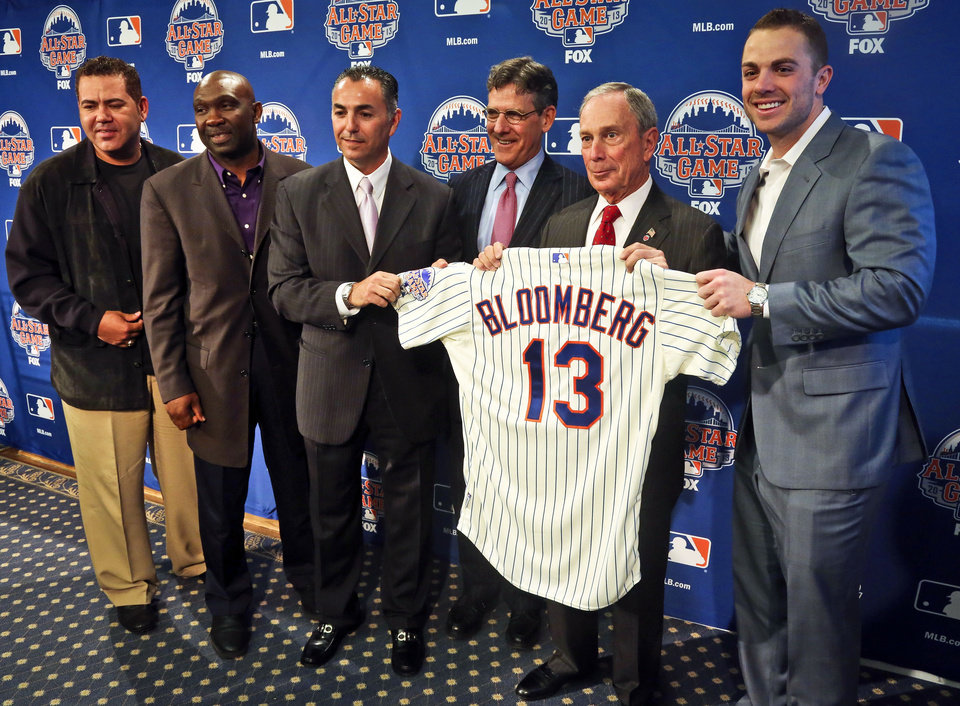 Photo - New York Mets Legends and Club Ambassadors, from left, Edgardo Alfonzo, Mookie Wilson, and John Franco, Major League Baseball Executive Vice President Tim Brosnan, Mayor Michael R. Bloomberg, and Mets third baseman David Wright, pose with a mets jersey presented to the mayor after a news conference to outline the festivities for baseball's All-Star game on Wednesday, April 24, 2013 in New York. The Mets are hosting the All-Star game on July 16. (AP Photo/Bebeto Matthews)