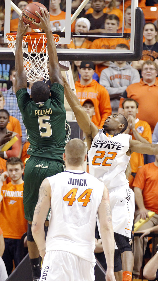 Photo - South Florida Bulls' Jawanza Poland (5) dunks the ball over Oklahoma State 's Markel Brown (22) during the college basketball game between Oklahoma State University (OSU) and the University of South Florida (USF) on Wednesday , Dec. 5, 2012, in Stillwater, Okla.   Photo by Chris Landsberger, The Oklahoman