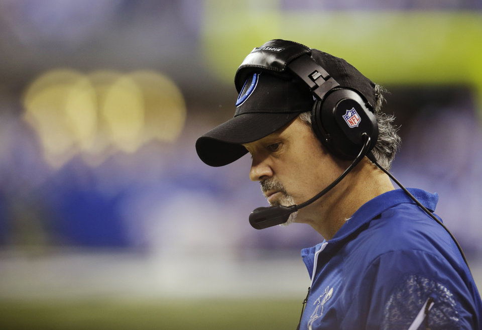 Photo - Indianapolis Colts head coach Chuck Pagano watches during the first half of an NFL wild-card playoff football game against the Kansas City Chiefs Saturday, Jan. 4, 2014, in Indianapolis. (AP Photo/AJ Mast)