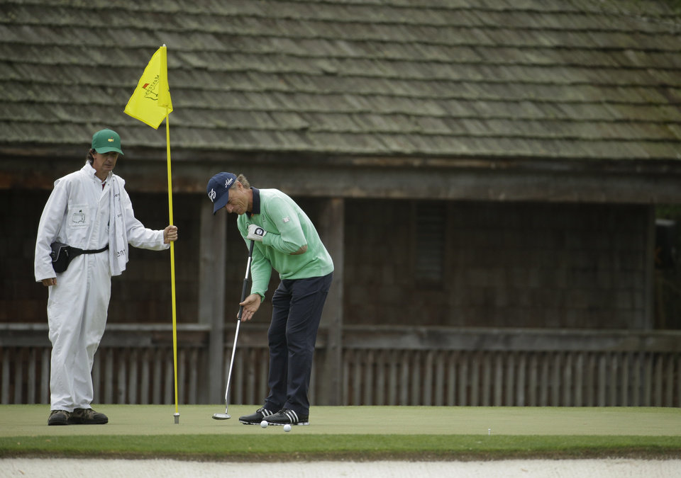 Photo - Bernhard Langer, of Germany, putts on the 11th green during a practice round for the Masters golf tournament Tuesday, April 8, 2014, in Augusta, Ga. (AP Photo/Chris Carlson)