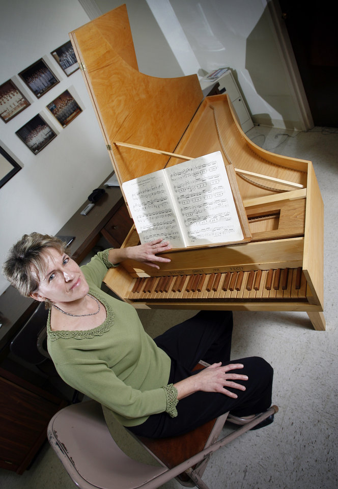 Shelbie Simmons, music director for Messiah Lutheran Church, poses for a photo next to a restored harpsichord which will be the featured instrument at an upcoming concert at Messiah Lutheran Church, 3600 Northwest Expressway, in Oklahoma City, Wednesday, February 20, 2008. BY NATE BILLINGS, THE OKLAHOMAN