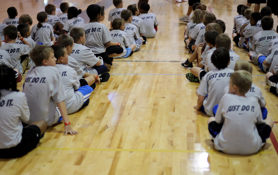 Children await instruction during the Kevin Durant basketball camp at Heritage Hall Wednesday, June 29, 2011.  Photo by Garett Fisbeck, The Oklahoman