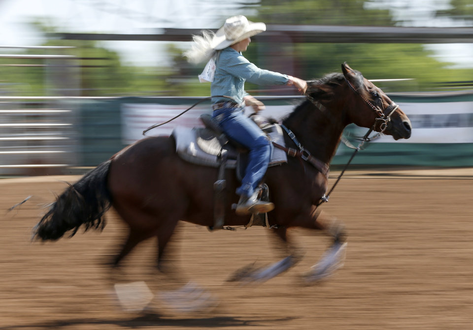 Photo - Jessi Schweer of Belle, Missouri, competes in barrel racing during the International Finals Youth Rodeo at the Heart of Oklahoma Exposition Center in Shawnee, Okla., Thursday morning, July 11, 2019. [Nate Billings/The Oklahoman]