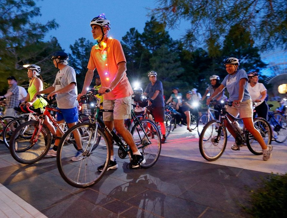 Mike O\'Meara, front left, of Edmond, Okla., and other cyclists begin the Full Moon Bicycle Ride organized by the Myriad Gardens and Schlegel Bicycles in Oklahoma City, Monday, July 22, 2013. Photo by Nate Billings, The Oklahoman