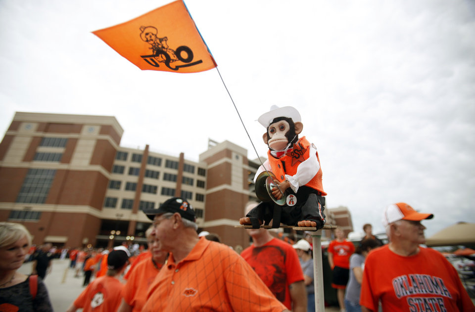 "Walter ""the Monkey Man"" Toney cheers during the Spirit Walk before the college football game between the Oklahoma State Cowboys (OSU) and the Nebraska Huskers (NU) at Boone Pickens Stadium in Stillwater, Okla., Saturday, Oct. 23, 2010. Toney has been bringing the money to games since 1980. Photo by Sarah Phipps, The Oklahoman"
