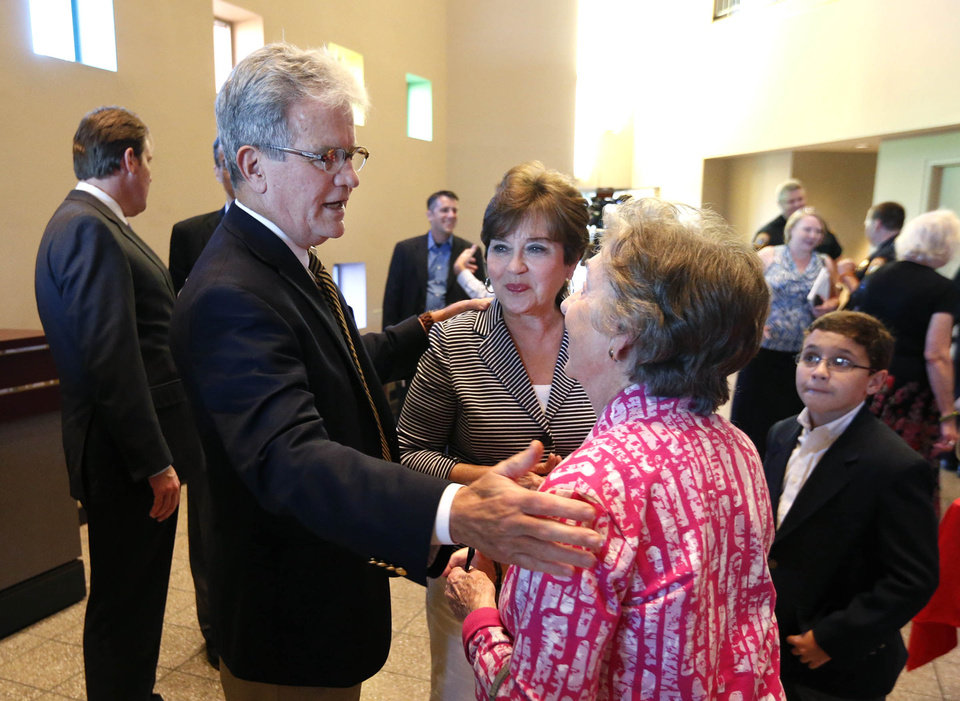 Photo - Sen. Tom Coburn (left) and his wife Carolyn Coburn (center) greet Levina Fleming before the senator's final town hall meeting at Tulsa Community College's VanTrease Performing Arts Center in Tulsa, Okla. on Wednesday, August 13, 2014. MATT BARNARD/Tulsa World