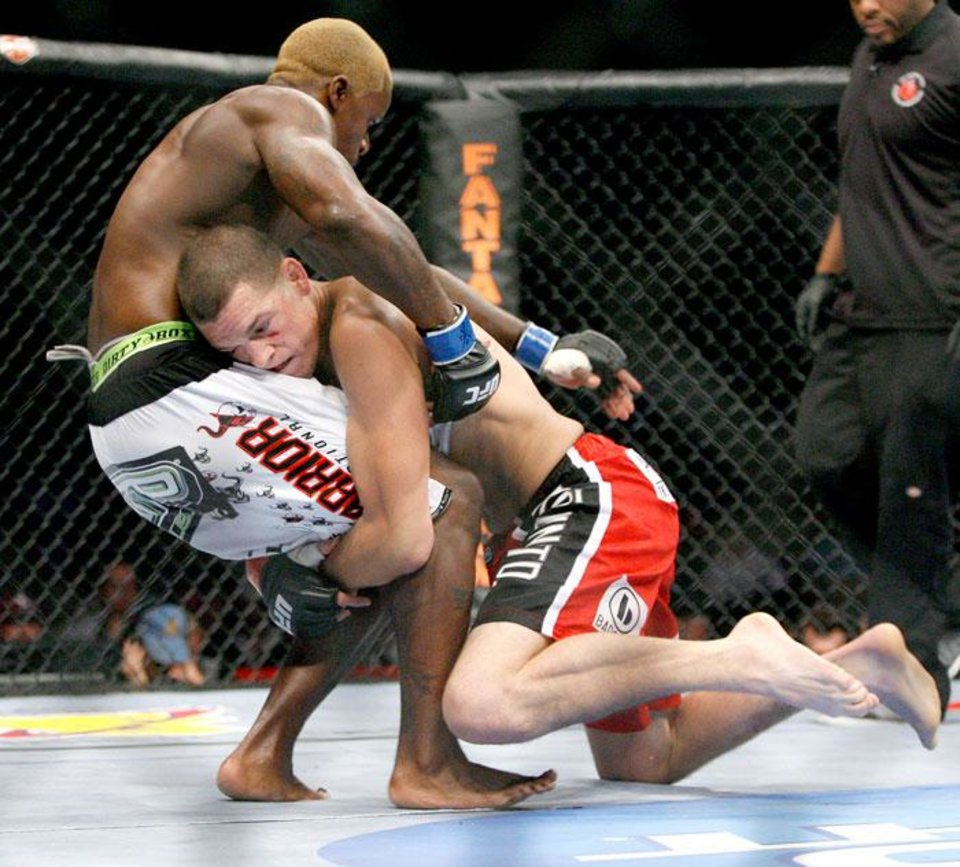Photo -  Melvin Guillard, left, fights Nate Diaz during UFC Fight Night at the Cox Convention Center in Oklahoma City, Wednesday, September 16, 2009.  Photo by Bryan Terry, The Oklahoman