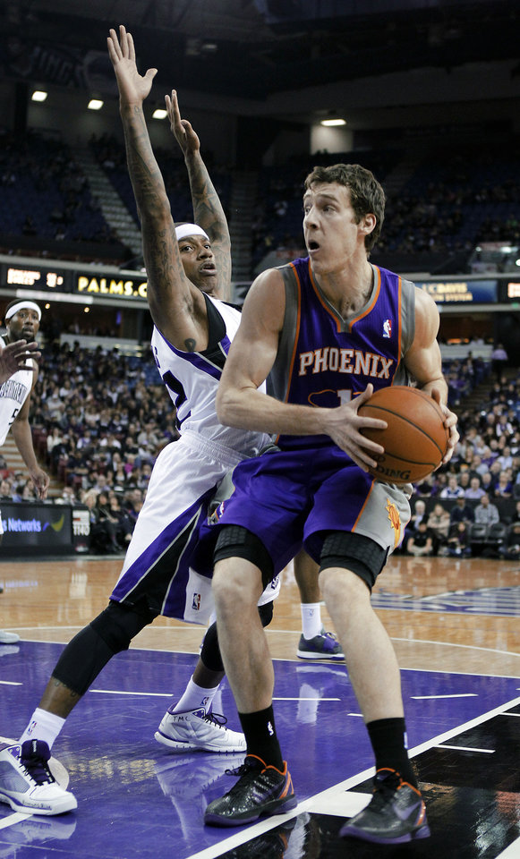 Sacramento Kings guard Isaiah Thomas, left, pressures Phoenix Suns guard Goran Dragic, of Slovenia, during the first quarter of an NBA basketball game in Sacramento, Calif., Wednesday, Jan. 23, 2013. (AP Photo/Rich Pedroncelli)
