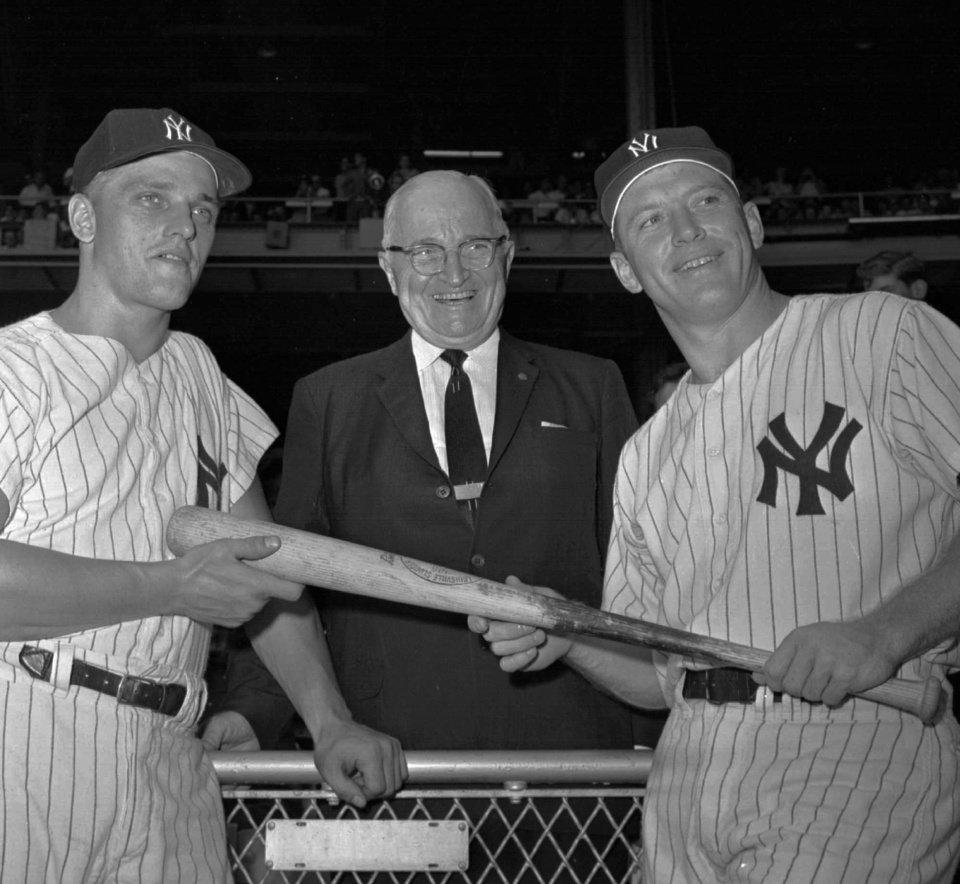 Photo - Former President Harry S. Truman is flanked by Yankees Roger Maris, left, and Mickey Mantle in this 1961 file photo in New York. (AP Photo/file)