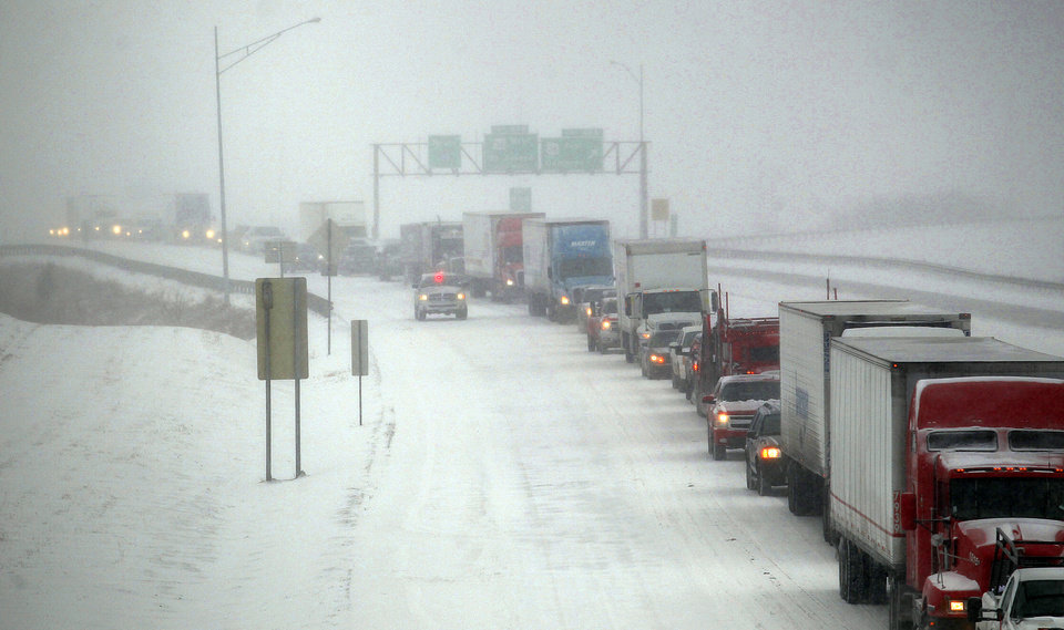 Photo - Traffic sits at a stand still on southbound Interstate 29, Tuesday, Feb. 4, 2014, in St. Joseph, Mo. An accident involving four vehicles caused the delays. (AP Photo/The St. Joseph News-Press, Jessica A. Stewart)