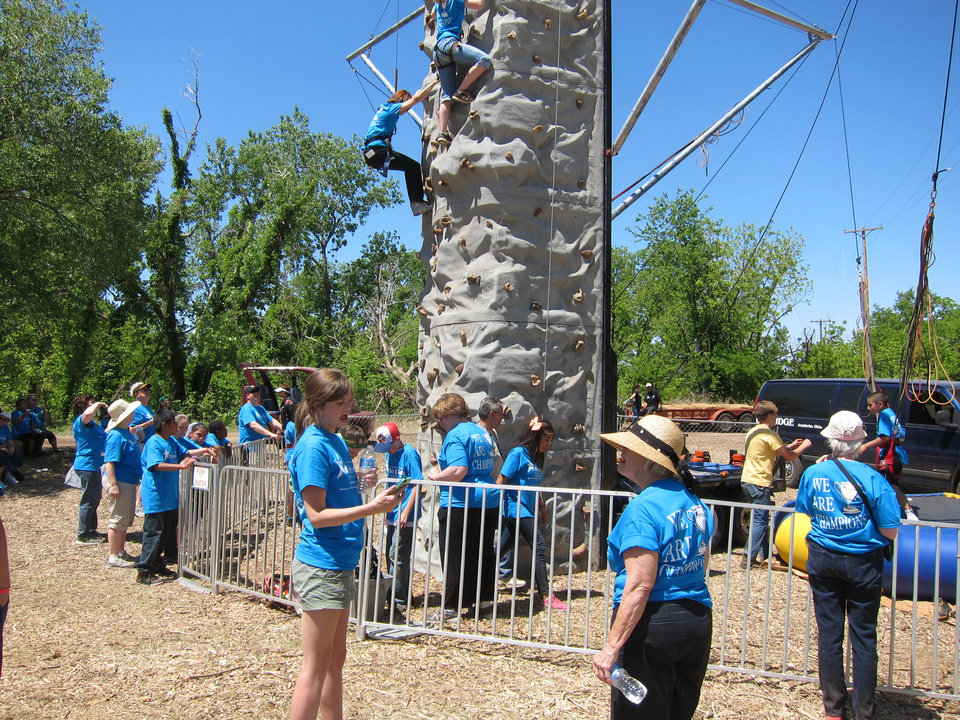"Photo -  Students involved in the faith-based Whiz Kids tutoring-mentoring program participate in rock climbing at the organization's recent ""Spring Fling"" end-of-year celebration at Crystal Lake. Photo by Carla Hinton, The Oklahoman"