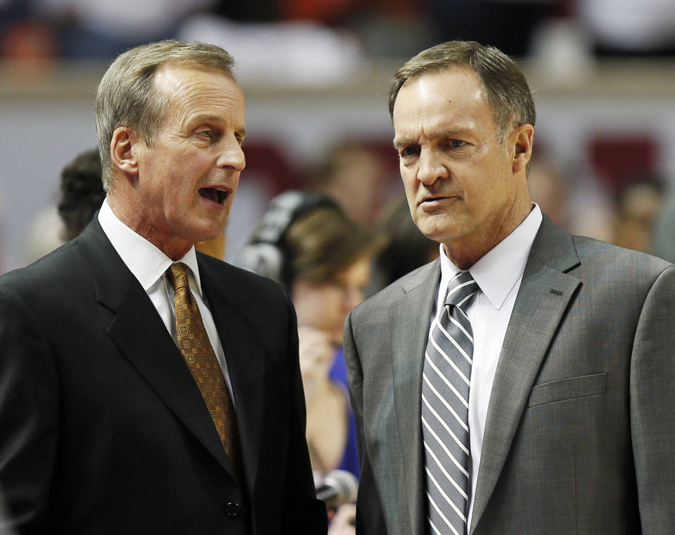 Photo - Texas head coach Rick Barnes, left, and Oklahoma head coach Lon Kruger talk before a men's college basketball game between the University of Oklahoma (OU) and the University of Texas at the Lloyd Noble Center in Norman, Okla., Monday, Jan. 21, 2013. Photo by Nate Billings, The Oklahoman