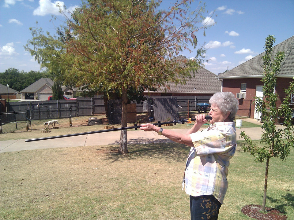 Photo - My grandma shooting darts with my cold steel blowgun.