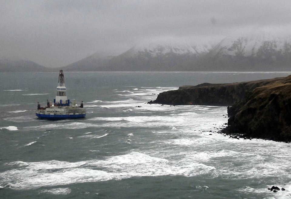 This image provided by the U.S. Coast Guard shows the Royal Dutch Shell drilling rig Kulluk aground off a small island near Kodiak Island Wednesday Jan. 2, 2013. There's no indication of a fuel leak from Kulluk, the Coast Guard said Wednesday night, Jan. 2, 2013, of a maritime accident that has refueled debate over oil exploration in the U.S. Arctic Ocean. (AP Photo/U.S. Coast Guard)