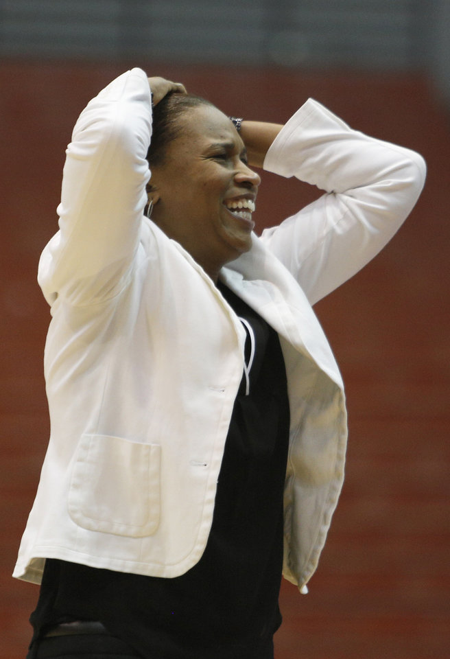 Photo - Cincinnati head coach Jamelle Elliott reacts during the first half of an NCAA college basketball game against Louisville, Saturday, March 1, 2014, in Cincinnati. (AP Photo/David Kohl)