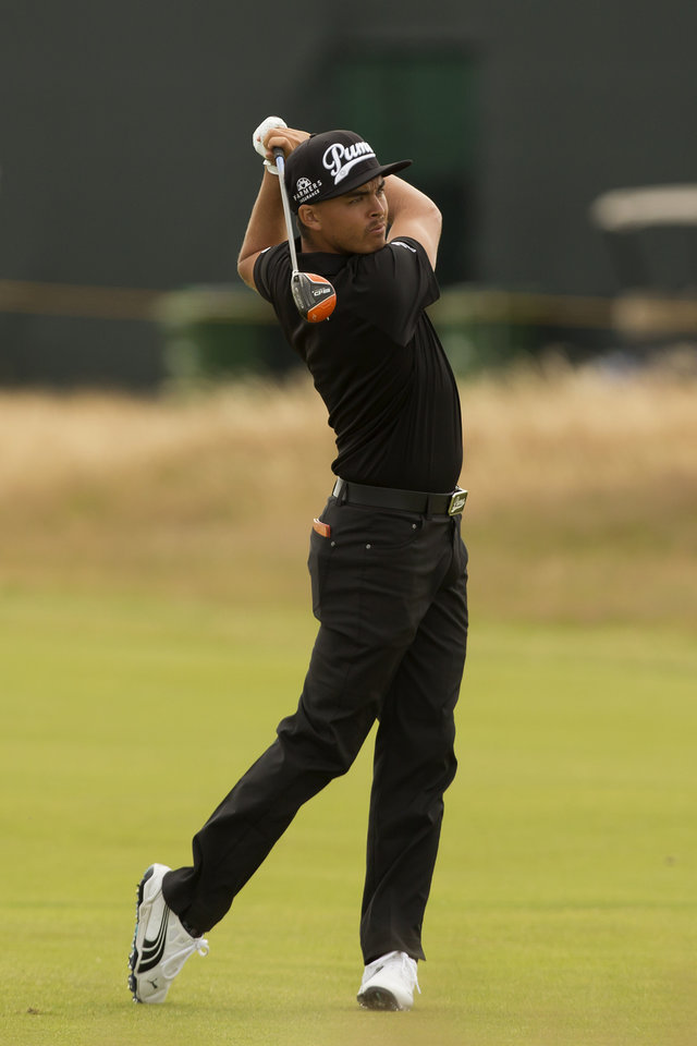 Photo - Rickie Fowler of the US plays a shot from the 6th fairway during a practice round at the Royal Liverpool Golf Club prior to the start of the British Open Golf Championship, in Hoylake, England, Monday, July 14, 2014. The 2014 Open Championship starts on Thursday, July 17. (AP Photo/Jon Super)