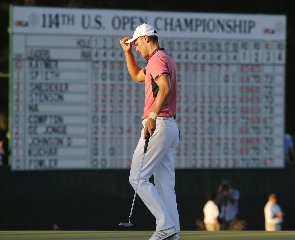 Photo - Martin Kaymer, of Germany, tips his cap after finishing the third round of the U.S. Open golf tournament in Pinehurst, N.C., Saturday, June 14, 2014. (AP Photo/Matt York)