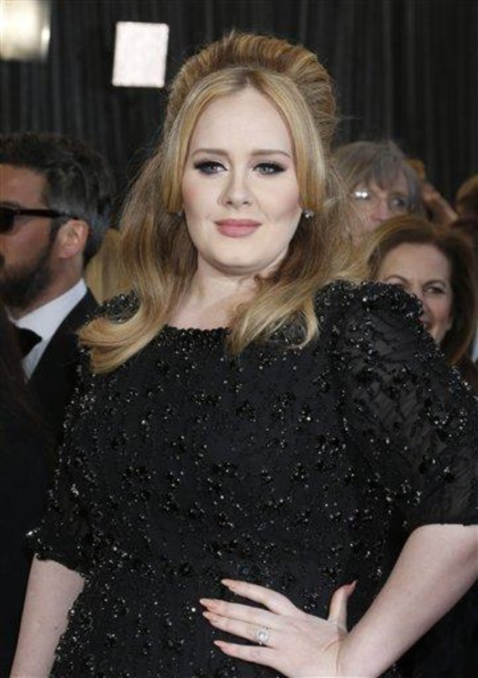 Singer Adele arrives at the Oscars at the Dolby Theatre on Sunday Feb. 24, 2013, in Los Angeles. (Photo by Todd Williamson/Invision/AP)