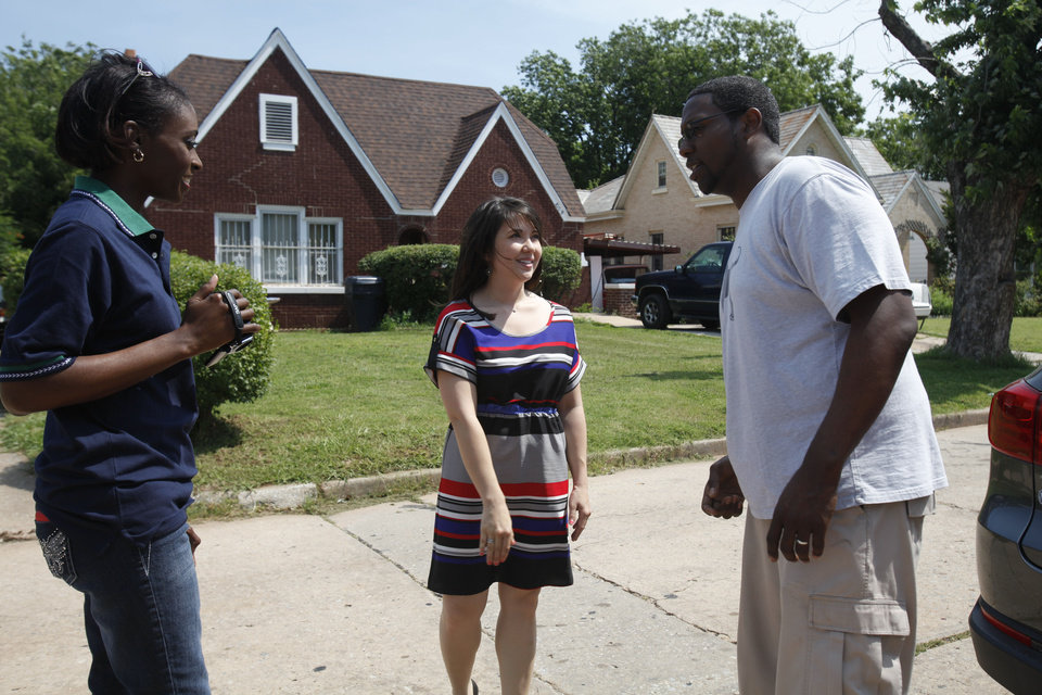 Photo - Nekeesha Barnett, a minister of Wheeler Avenue Baptist Church in Houston, Texas, at left, and the Rev. Semaj Vanzant, senior pastor of Christ United Methodist Church in Oklahoma City,at right, talk to Adela Porter, in center, a victim of the May 20 tornado in Moore.  Aliki Dyer - The Oklahoman