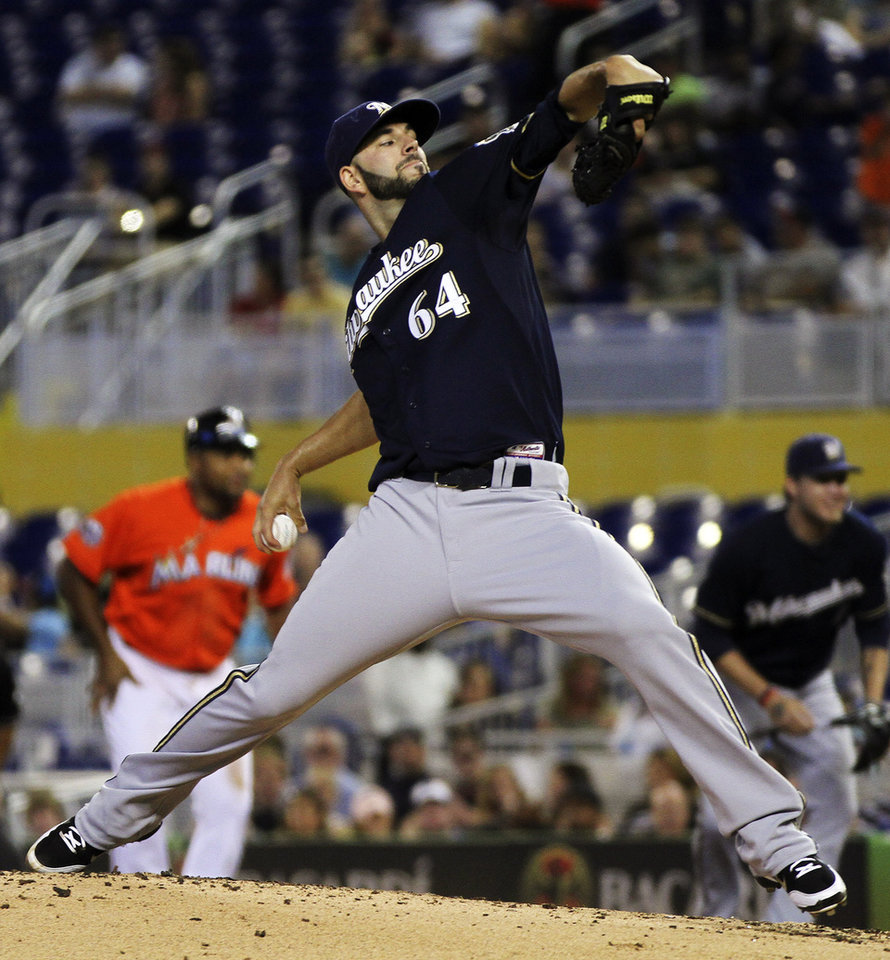Photo -   Milwaukee Brewers starter Mike Fliers pitches to the Miami Marlins during the third inning of a B baseball game in Miami, Monday, Sept. 3, 2012. (AP Photo/J Pat Carter)