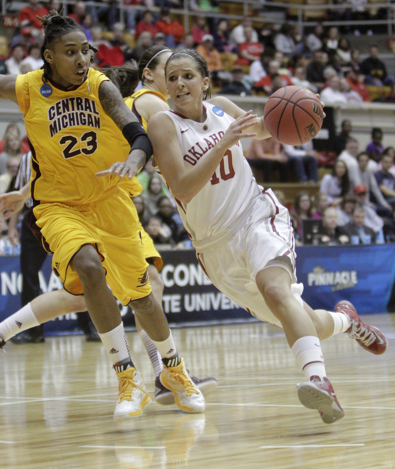 Oklahoma's Morgan Hook, right, drives to the basket against Central Michigan's Crystal Bradford during the second half of a first-round game in the women's NCAA college basketball tournament Saturday, March 23, 2013, in Columbus, Ohio. Oklahoma beat Central Michigan 78-73. (AP Photo/Jay LaPrete) ORG XMIT: OHJL106