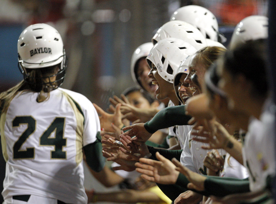 Photo - The Baylor bench cheer during the Women's College World Series game between Baylor and Missouri at the ASA Hall of Fame Stadium in Oklahoma City, Saturday, June 4, 2011. Photo by Sarah Phipps, The Oklahoman