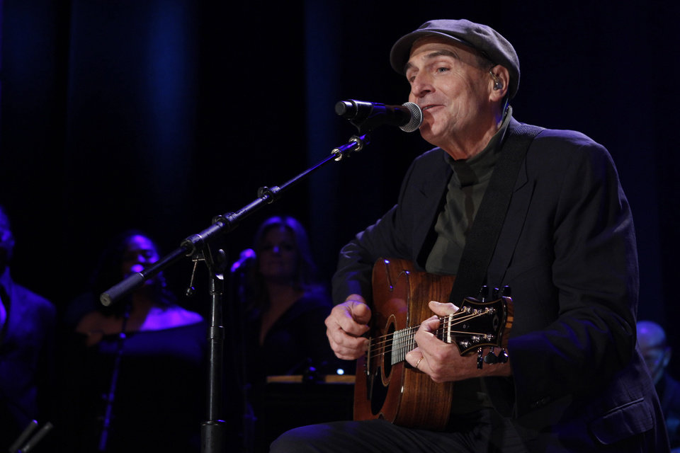 Photo - FILE - This Oct. 21, 2012 file photo shows James Taylor at the Country Music Hall of Fame Inductions in Nashville, Tenn. Aerosmith, James Taylor, and Jimmy Buffett are among the scheduled performers for a Boston Marathon benefit concert May 30. The show, at the TD Garden, will benefit One Fund _ the collection of donations that will be distributed to the survivors of the April 15 bombings and the families of those killed in the attack. (Photo by Wade Payne/Invision/AP, file)