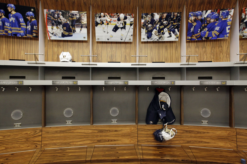 Photo - FILE -In this Sept. 25, 2012 file photo, an empty locker room is shown during the NHL labor lockout at the First Niagara Center, home of the Buffalo Sabres hockey team, in Buffalo, N.Y. The NHL lockout that's already wiped out the first three months of the season is taking its toll on Buffalo businesses. And it's no different in many of the NHL's 29 other markets. (AP Photo/David Duprey, File)