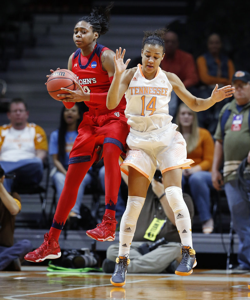 Photo - St. John's forward Amber Thompson, left, pulls a rebound away from Tennessee guard Andraya Carter (14) in the first half of an NCAA women's college basketball second-round tournament game Monday, March 24, 2014, in Knoxville, Tenn. (AP Photo/John Bazemore)