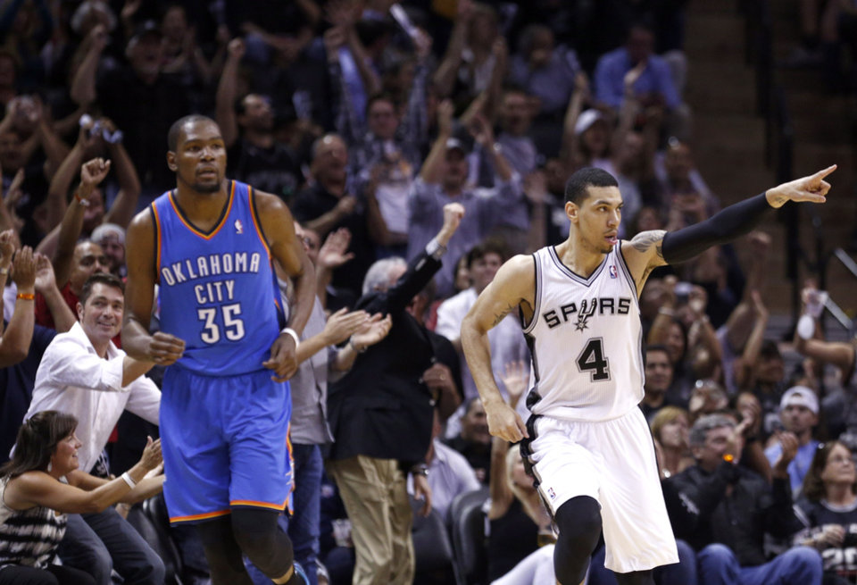 San Antonio's Danny Green (4) celebrates his 3-point shot in front of Oklahoma City's Kevin Durant (35) during Game 2 of the Western Conference Finals in the NBA playoffs between the Oklahoma City Thunder and the San Antonio Spurs at the AT&T Center in San Antonio, Wednesday, May 21, 2014. Photo by Sarah Phipps