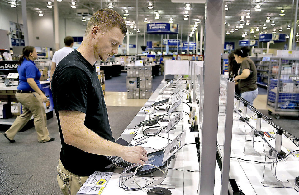 Photo - Kevin Willis shops for a tablet at Best Buy, 5801 N May Ave. Photos by CHRIS LANDSBERGER, The Oklahoman