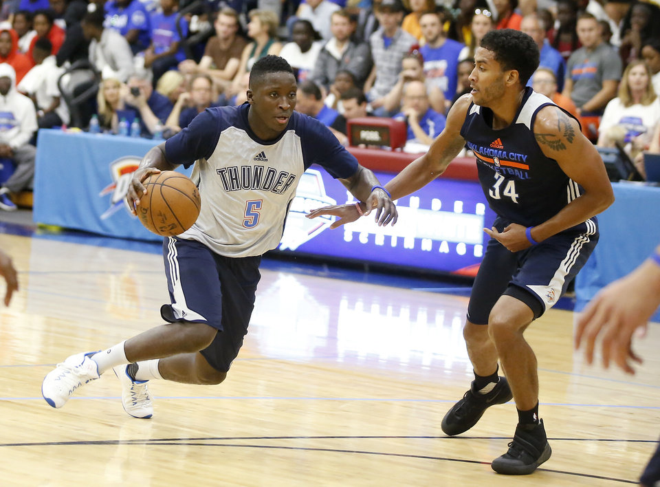 Photo - Oklahoma City's Victor Oladipo goes past Josh Huestis during the Thunder's annual Blue and White Scrimmage at John Marshall Mid-High School in Oklahoma City, Tuesday, Sept. 27, 2016. Photo by Bryan Terry, The Oklahoman