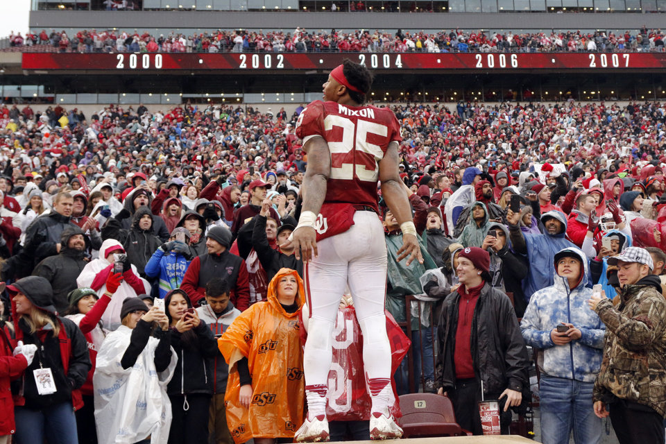 Photo - Oklahoma's Joe Mixon (25) celebrates with the crowd following the Bedlam college football game between the Oklahoma Sooners (OU) and the Oklahoma State Cowboys (OSU) at Gaylord Family - Oklahoma Memorial Stadium in Norman, Okla., Saturday, Dec. 3, 2016. Photo by Steve Sisney, The Oklahoman
