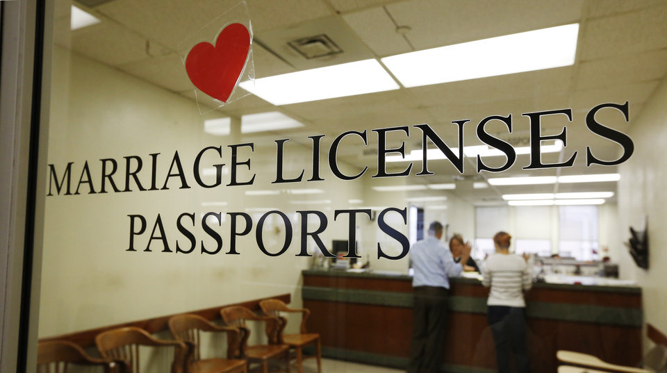 Photo - Sign on the front door to the marriage license counter at the Oklahoma County  Annex Building in Oklahoma City Monday, Oct. 6, 2014. The ban on same sex marriages was lifted Monday. Photo by Paul B. Southerland, The Oklahoman