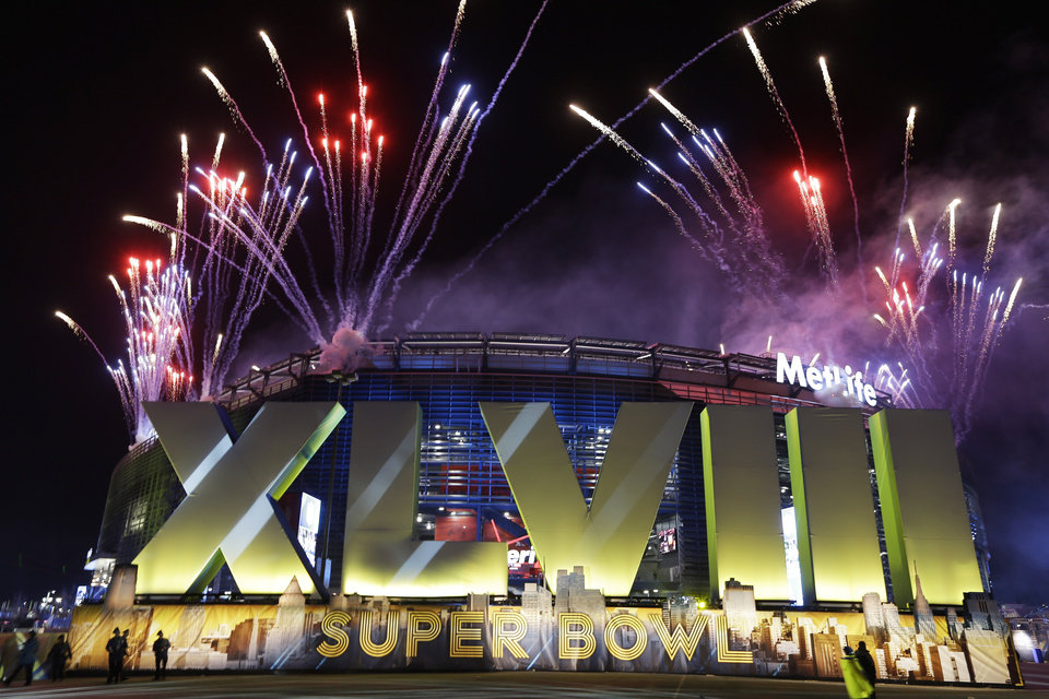 Photo - Fireworks burst over MetLife Stadium before the NFL Super Bowl XLVIII football game between the Seattle Seahawks and the Denver Broncos, Sunday, Feb. 2, 2014, in East Rutherford, N.J. (AP Photo/Seth Wenig)