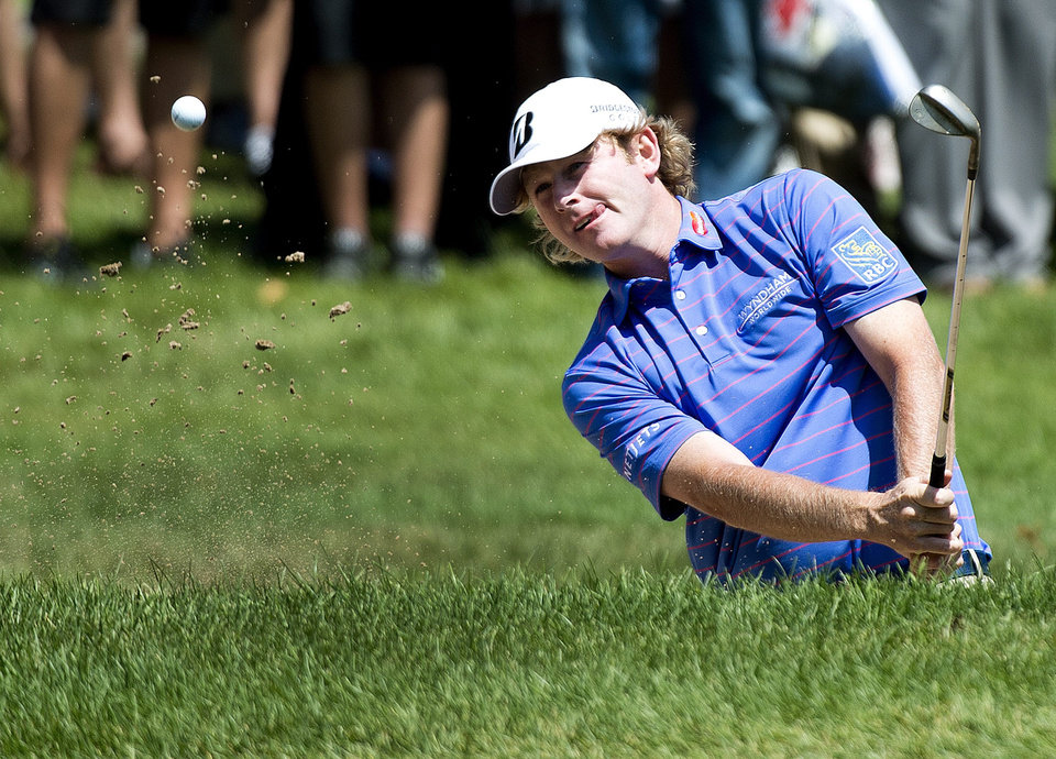Photo - Brandt Snedeker, of the United States, blasts out of the bunker on the second hole during the final round of play at Glen Abbey at the Canadian Open golf tournament in Oakville, Ontario, Sunday, July 28, 2013. (AP Photo/The Canadian Press, Nathan Denette)