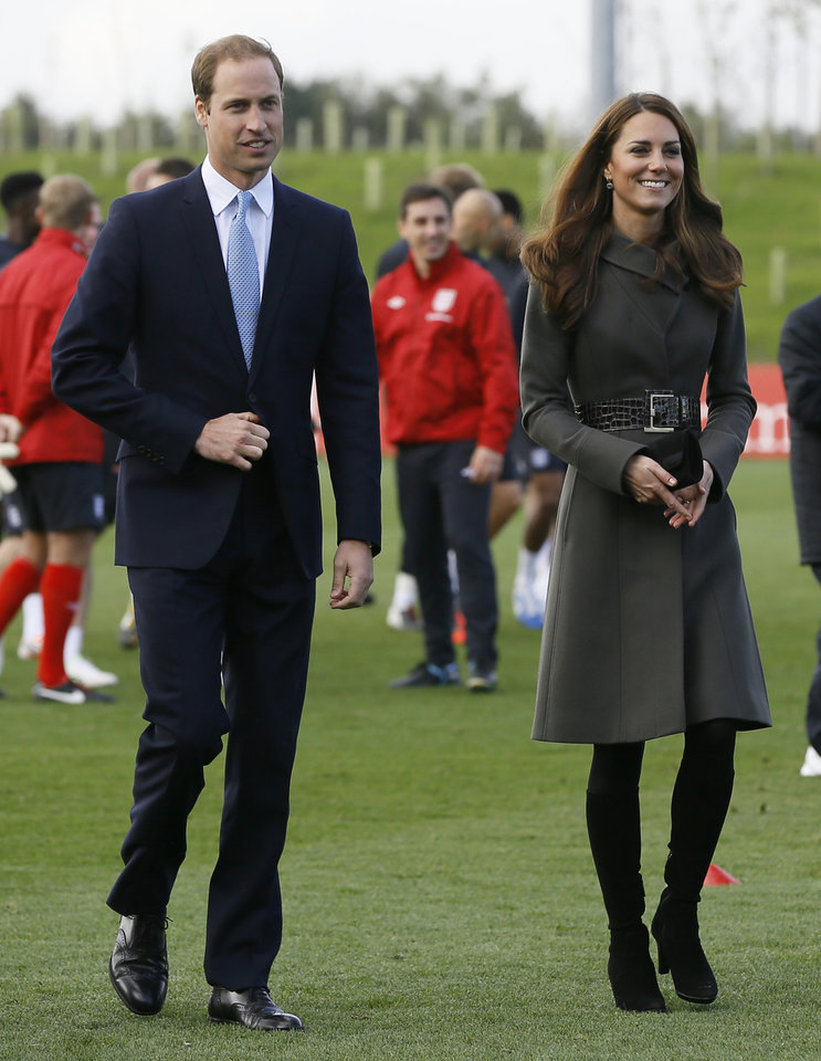Photo -   Britain's Prince William , left and Kate, Duchess of Cambridge, walk as they view a football training pitch at St George's Park near Burton Upon Trent in Staffordshire, England, Tuesday, Oct. 9, 2012. Britain's Duke and Duchess of Cambridge visited the new national training facility for England's football teams, to officially open the 330 acre site which includes indoor and outdoor training pitches, a hotel, conference centre, medical facilities, health club and spa. (AP Photo/Kirsty Wigglesworth)