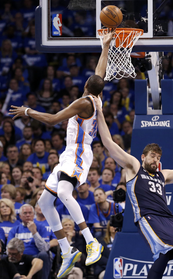 Oklahoma City\'s Kevin Durant (35) shoots a lay up over Memphis\' Marc Gasol (33) during Game 1 in the second round of the NBA playoffs between the Oklahoma City Thunder and the Memphis Grizzlies at Chesapeake Energy Arena in Oklahoma City, Sunday, May 5, 2013. Photo by Sarah Phipps, The Oklahoman