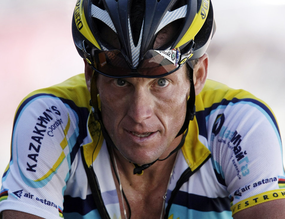 Photo - FILE - In this July 19, 2009, file photo, Lance Armstrong crosses the finish line during the 15th stage of the Tour de France cycling race in Verbier, Switzerland. Armstrong confessed to using performance-enhancing drugs to win the Tour de France during a taped interview with Oprah Winfrey that aired Thursday, Jan. 17, 2013, reversing more than a decade of denial. (AP Photo/Laurent Rebours, File)