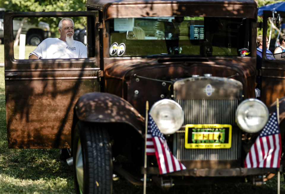 Darryl Schenck sits in the shade while enjoying the car show during the Yukon Freedom Fest at the Yukon City Park on Thursday , July 4, 2013, in Yukon, Okla. Photo by Chris Landsberger, The Oklahoman