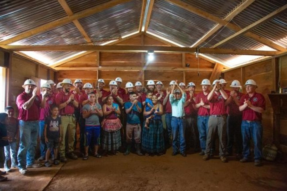 Photo -  Members of an Energy Trails team made up of volunteers from electric cooperatives in Oklahoma and Colorado celebrate the completion of a project to electrify Sillab, Guatemala with some of its villagers.