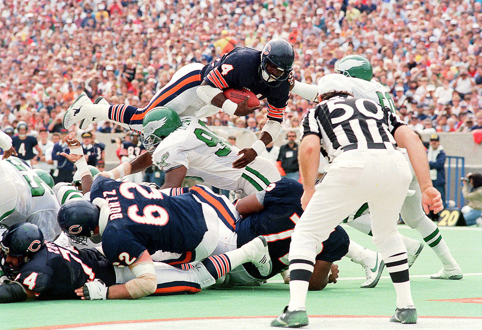 Photo - Chicago Bears running back Walter Payton is airborne as he plunges into the endzone for his 100th career touchdown in third quarter action against the Philadelphia Eagles in Chicago, Ill., Sept. 14, 1986.  Payton also carried 33 times for 176 yards and broke a 15,000-yard career mark.  (AP Photo/Mark Elias)