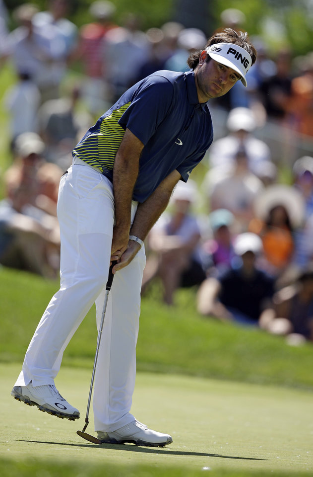 Photo - Bubba Watson reacts to a missed putt on the ninth green during the second round of the Memorial golf tournament Friday, May 30, 2014, in Dublin, Ohio. (AP Photo/Darron Cummings)